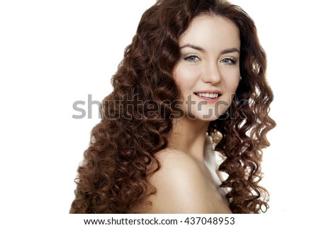 Portrait of a beautiful girl with long curly hair