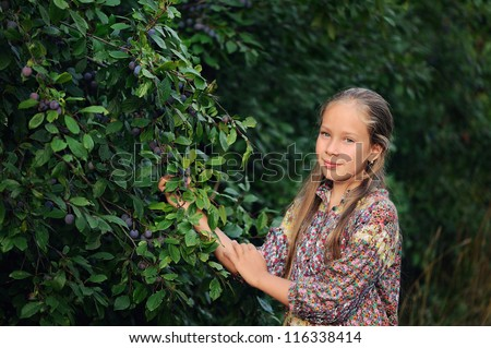 portrait of a beautiful girl with long hair on the nature - stock photo
