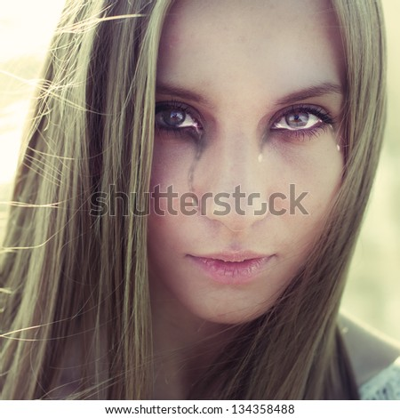 portrait of a beautiful girl with tears - stock photo