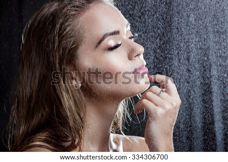 Portrait of a beautiful girl with wet hair. Girl under water drops - stock photo