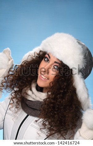 portrait of a beautiful girl with winter hat