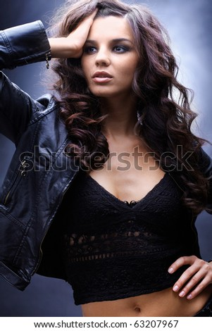 Portrait of a beautiful glamorous brunette in leather jacket - stock photo