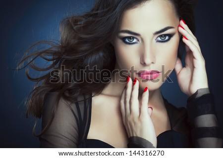 Portrait of a beautiful glamorous woman posing. - stock photo