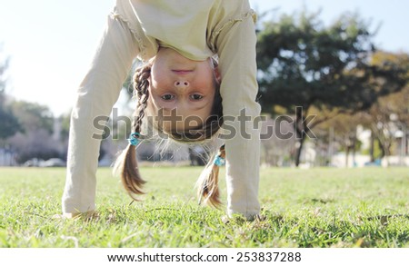 portrait of a beautiful happy girl outdoors - stock photo
