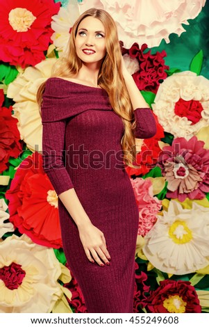 Portrait of a beautiful happy woman posing on a background of bright large flowers. Beauty, fashion. Summer inspiration. - stock photo