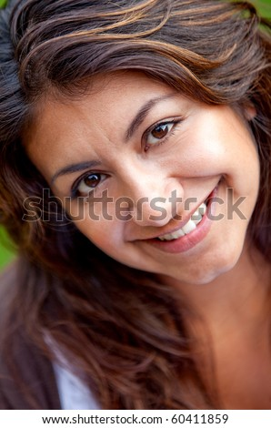 Portrait of a beautiful happy woman smiling