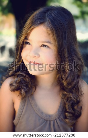 Portrait of a beautiful happy young girl - stock photo