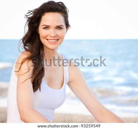 Portrait of a beautiful healthy young woman relaxing on the beach