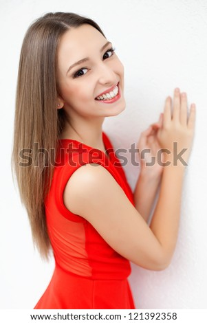 portrait of a beautiful healthy young women model view in luxurious red dress on a white background. Series. - stock photo