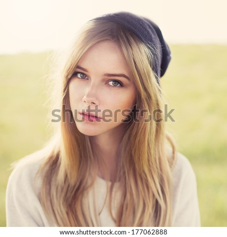 portrait of a beautiful hipster girl outdoors on a sunny morning - stock photo