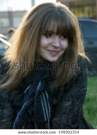 Portrait of a beautiful, humble girl, a close-up. - stock photo