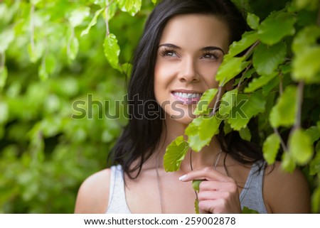 Portrait of a beautiful indian girl in park - stock photo