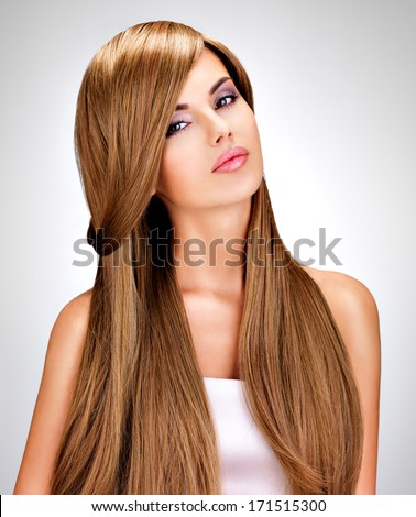 Portrait of a beautiful  indian  woman with long straight brown  hair.  - stock photo