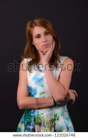 portrait of a beautiful lady in dress in studio - stock photo