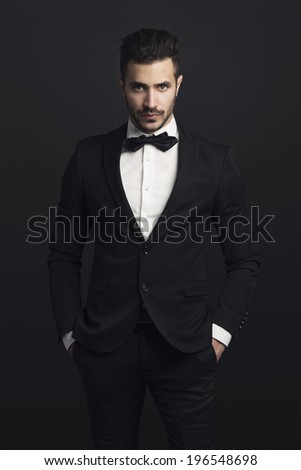 Portrait of a beautiful latin man smiling wearing a tuxedo