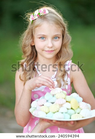 portrait of a beautiful little girl girl in pink - stock photo