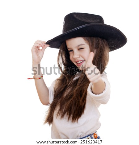 Portrait of a beautiful little girl in a black cowboy hat, studio on white isolated background