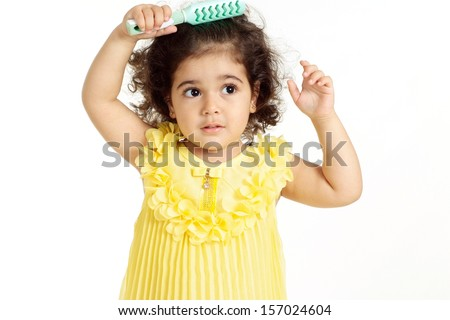 portrait of a beautiful little girl in a yellow dress on a white background