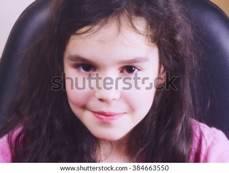 Portrait of a beautiful little girl (in soft tones, retro style) - stock photo