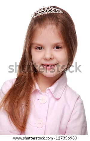 Portrait of a beautiful little girl with a tiara on her head on Holiday theme/Lovely blond hair little girl - stock photo