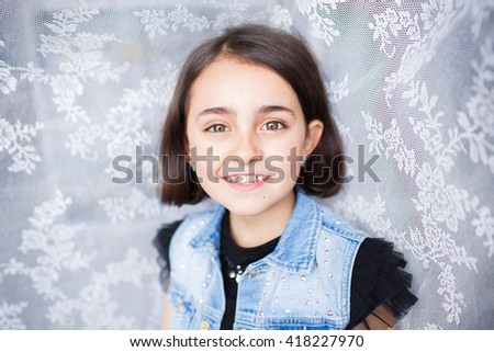 Portrait of a beautiful little girl with emotions - stock photo