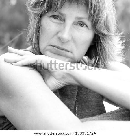 Portrait of a beautiful mature woman, monochrome - stock photo