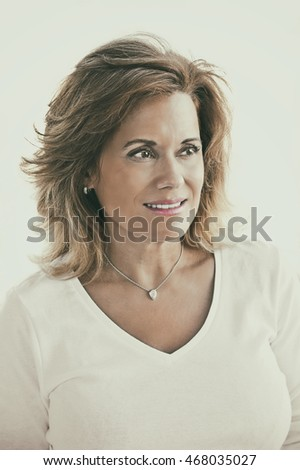 Portrait of a Beautiful Mature Woman wearing White Top
