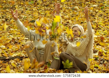 Portrait of a beautiful middle-aged couple on a walk in the early autumn - stock photo