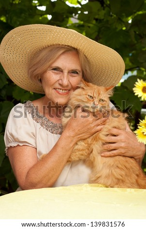 portrait of a beautiful middle-aged woman in the summer outdoors