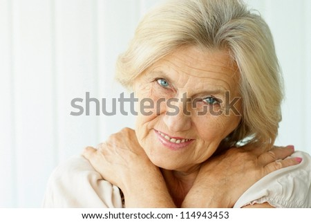 portrait of a beautiful middle-aged woman on a light background