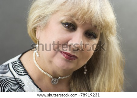Portrait of a beautiful middle-aged women - stock photo