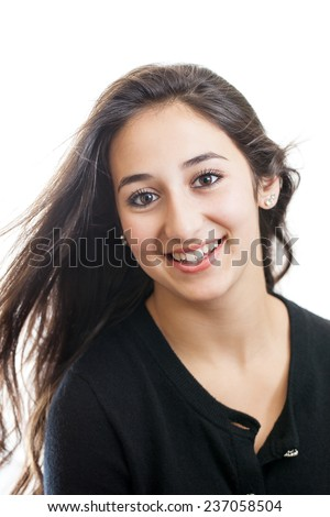 Portrait of a beautiful mixed race teen girl with windblown hair isolated on a white background - stock photo