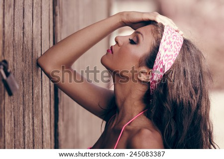 Portrait of a beautiful mixed woman with pink hair scarf