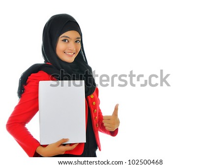 Portrait of a beautiful Muslim woman holding a white paper with smile, isolated on white background