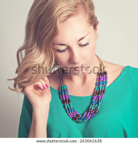 Portrait of a beautiful mysterious blonde woman. - stock photo