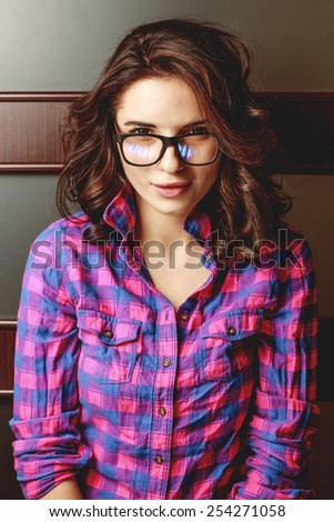 Portrait of a beautiful natural girl in glasses - stock photo