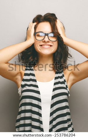 Portrait of a beautiful natural girl on a grey background. - stock photo