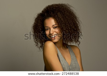 Portrait of a beautiful natural young African woman smiling happiness - stock photo
