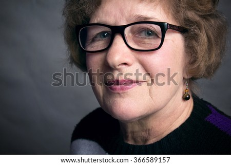 portrait of a beautiful older woman with glasses
