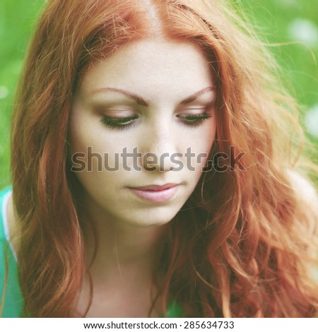 portrait of a beautiful red-haired girl
