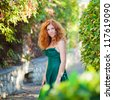 Portrait of a beautiful redheaded woman - stock photo