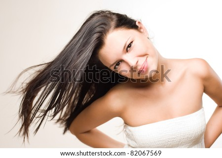 Portrait of a beautiful relaxed young brunette with flowing hair.