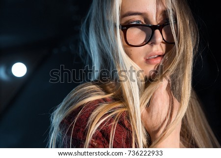 Portrait of a beautiful sensual girl in glasses