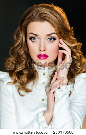 Portrait of a beautiful sensual glamorous red-haired girl in a white blouse, in the Studio on a dark background, close up - stock photo