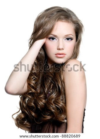 Portrait of a beautiful  sensual young woman with  long curly hairs - isolated on white - stock photo
