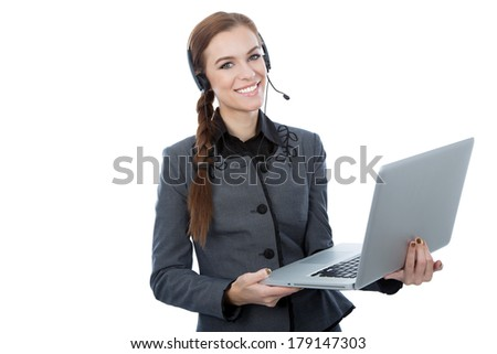 Portrait of a beautiful service customer worker holding a laptop. White background. Beautiful smile.