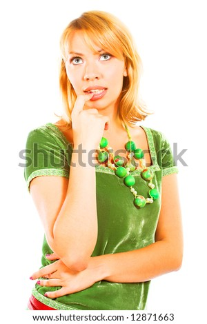 Portrait of a beautiful, sexy blond girl in green dress