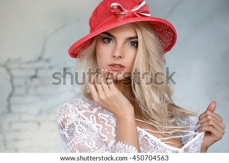 portrait of a beautiful sexy blonde in a red hat