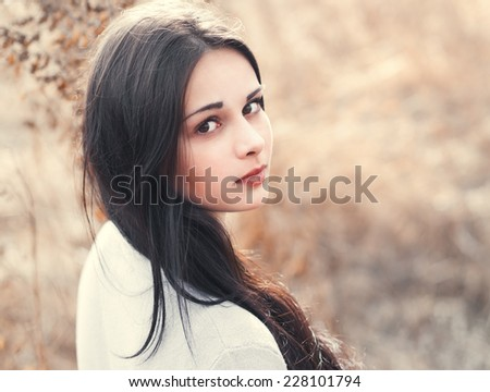 portrait of a beautiful sexy brunette closeup on a sunny day - stock photo