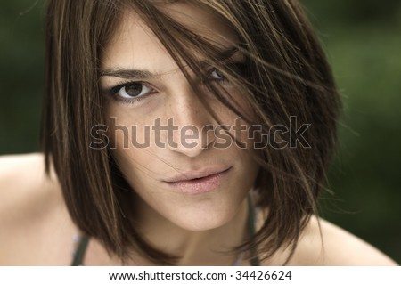 Portrait of a beautiful, sexy brunette girl, with wind in the hair